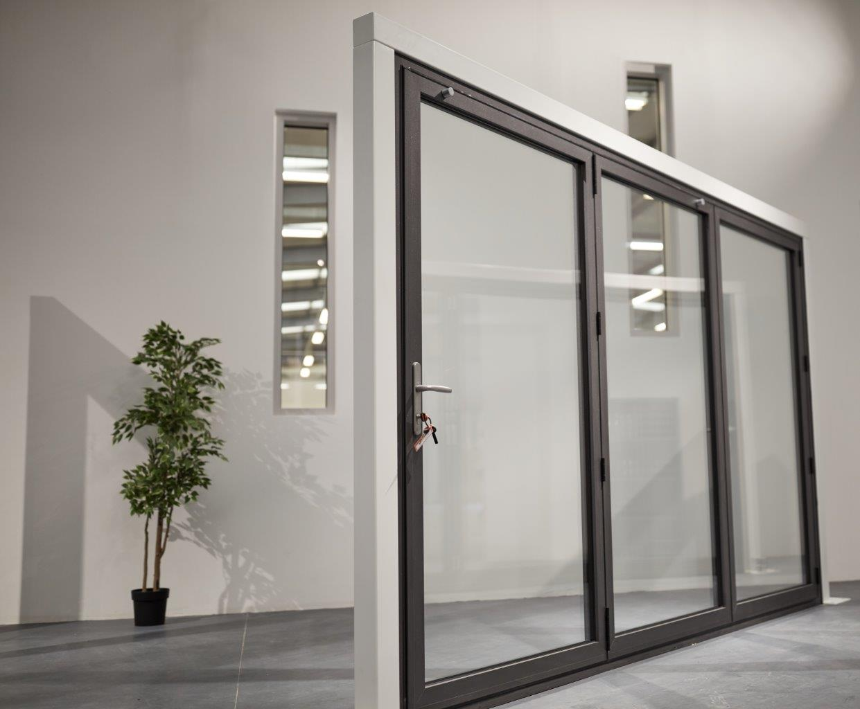 Clear View Bi-folding Doors in showroom with locking mechanism 3 ...