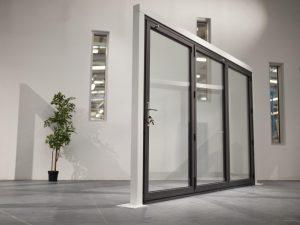 Clear View Bi-folding Doors in showroom with locking mechanism