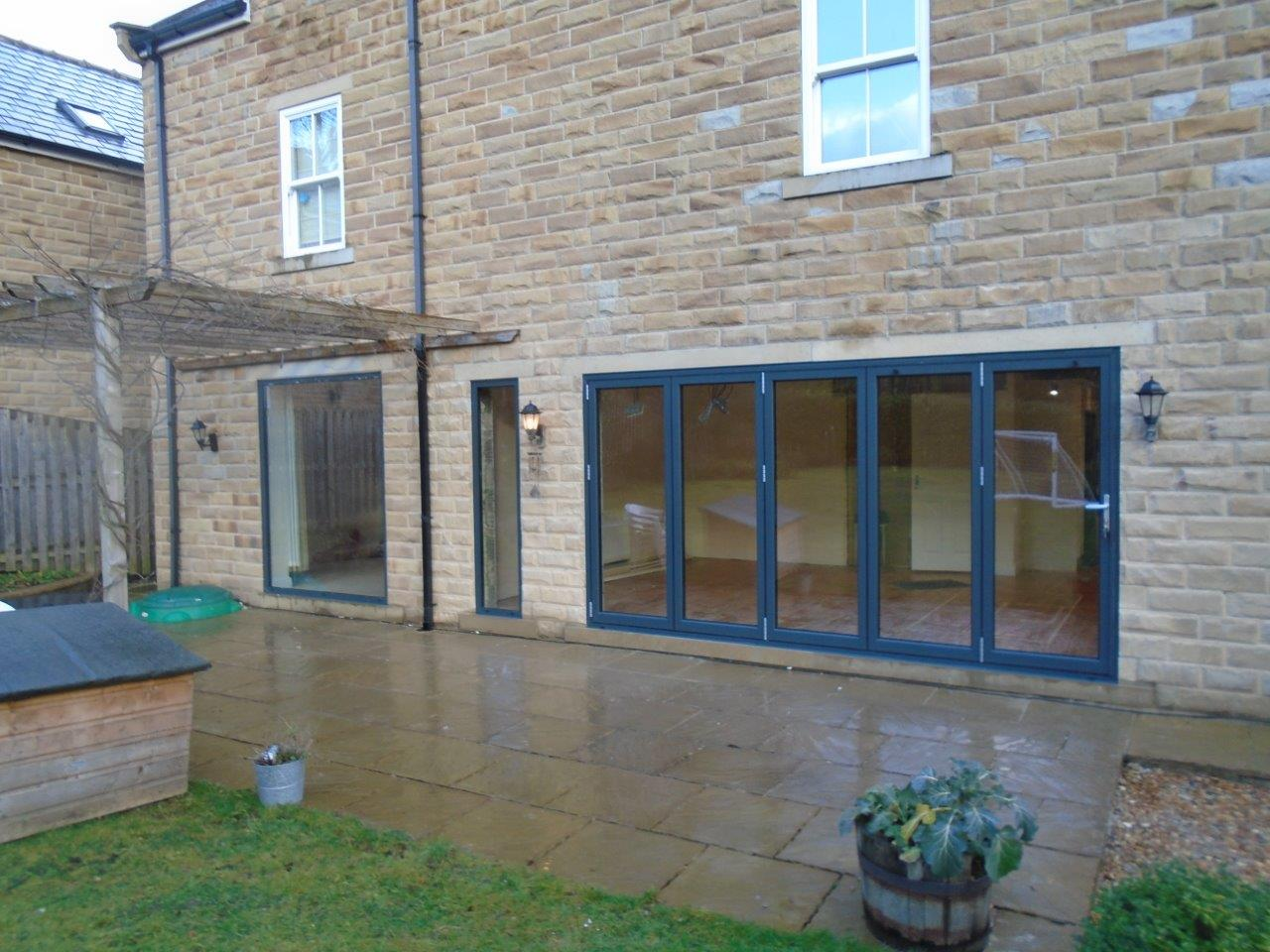 Custom Aluminium bi-folding patio doors